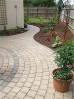 Block paving pathway garden design from Cambridge paving and patios showing paving patterns.