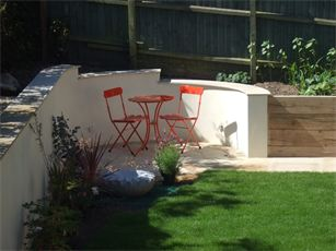 Garden retaining wall and natural stone paved circle Cambridge Landscapers